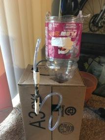 Bottle, Hose, Servo, and box I used as a fixture